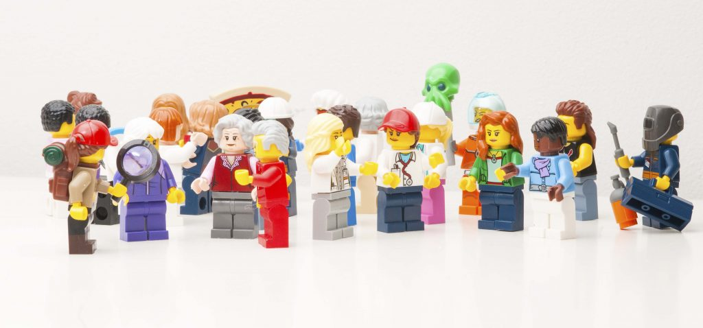 group of minifigs representing diverse group for rentenion of people